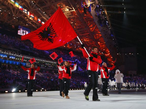 Skier Erjon Tola of the Albania Olympic team carries his country's flag during the Opening Ceremony of the Sochi 2014 Winter Olympics at Fis...