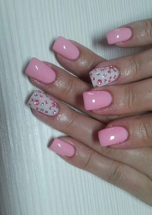Pink nails with pink and silver rhinestones and white ring finger. #nails