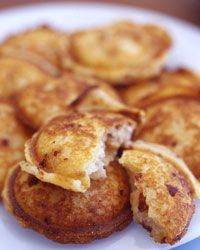 Arepas, fried or baked skillet breads made from corn flour, are eaten night and day in Venezuela (usually stuffed) and Colombia (usually not). Bernstein says they're also her favorite snack at street fairs and carnivals in Miami. Here, she makes mini arepas, or arepitas, to serve as canapés, adding cheese and chorizo to the dough. They're her answer to the corn dog.