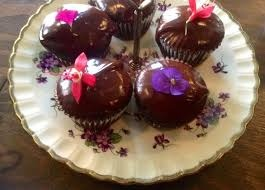 fuchsia flower grocery   decadent chocolate and edible flower cupcakes!