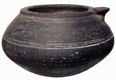"""Early Armenia, c. 1000 BC. Fantastic large ceramic pot. Nice round thumb-handle on rim, great design of multiple incised ridges around upper body. Black color indicates it was probably burned in antiquity. Intact except for a small hairline age crack on one edge. 155 mm (6 1/4"""") wide and 97 mm (3 3/4"""") tall. A beautiful piece! From my own personal collection. #arm271039: $499 SOLD"""