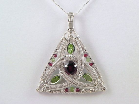 Celtic garnet and peridot sterling argentium silver wire wrap pendant. $400.00, via Etsy.