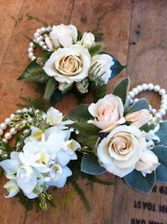 pearl wristlet corsages  For denver metro  call 303-722-6113  Floral Expressions & Gourmet Goodies  starting at $25.99   call to customize