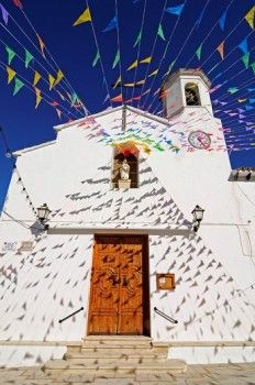 Small colourful flags outside Santa Ana Church during fiesta, Altea la Vella, Alicante, Costa Blanca, Spain