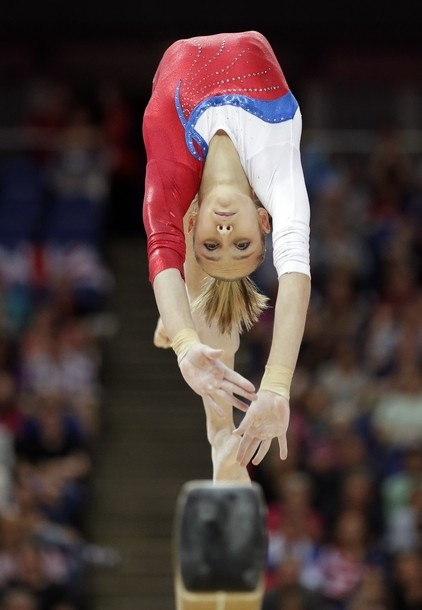 plus 2/0 Russian gymnast Victoria Komova performs on the balance beam during the artistic gymnastics women's apparatus finals at the 2012 Summer Olympics, Tuesday, Aug. 7, 2012, in London.