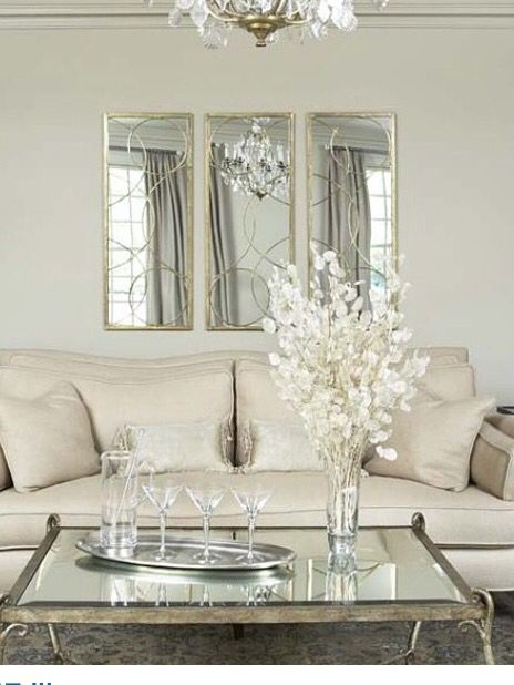 3 mirrors above couch.                                                                                                                                                     More