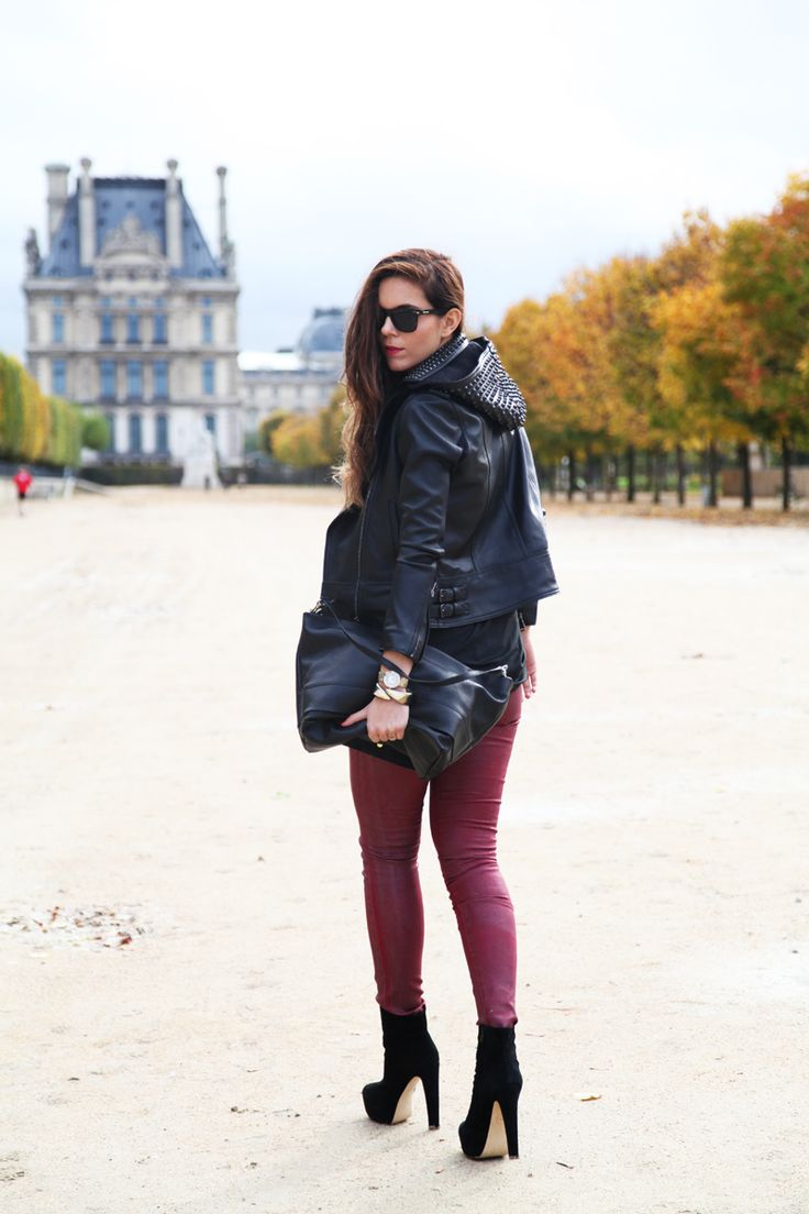 Black leather jacket with a studded hood, some killer heels and burgundy jeans