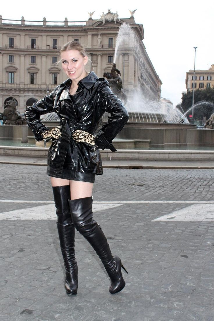 women in short pvc skirt and coat   thigh high leather boots