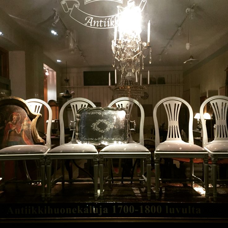 Antique chairs at the shop window in Helsinki