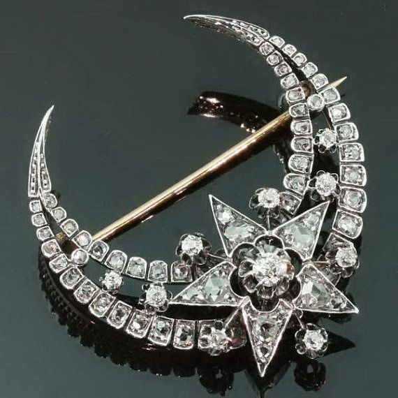 Crescent brooches were popular throughout the 1800's. They seemed to cycle into fashion every 30 years or so. This one features ten Old Mine Cut diamonds totaling .75 tcw. The other diamonds are Rose Cuts- about .68tcw of them. It is silver topped with an 18kt yellow gold back. This one was made circa 1870. See more here http://www.jewelrynerd.org/blog.html