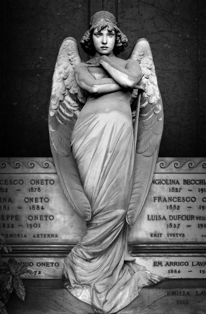 Angel Monument staglieno | there is a sad look on the face of the angel guarding the tomb of the ...