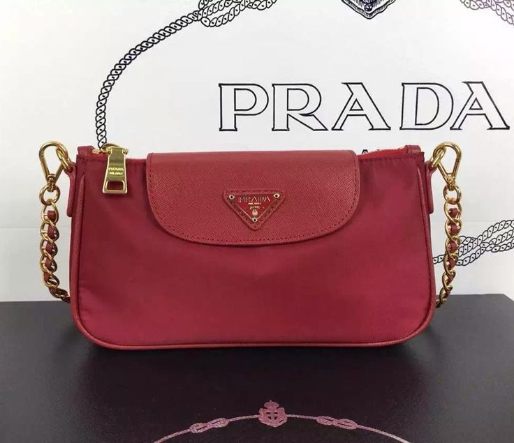Prada nylon tessuto saffiano wristlet comes with a leather interwined chain with golden hardware, a flap and top zip closure, and an interior zipper pocket.  Click here http://www.dfodiscountbags.ch/prada-nylon-tessuto-saffiano-wristlet-p0779red.html
