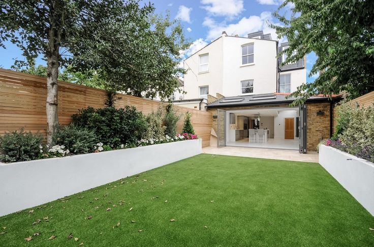 modern garden design london artificial grass travertine paving render painted raised beds