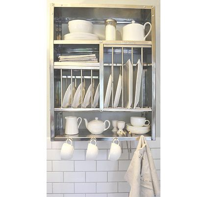 This is such a great solution for anyone without a dishwasher. Use the space above the sink to store and air-dry dishes.
