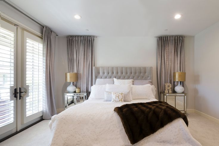 In the master bedroom, the bed is from Z Gallerie and the end tables are from Restoration Hardware.