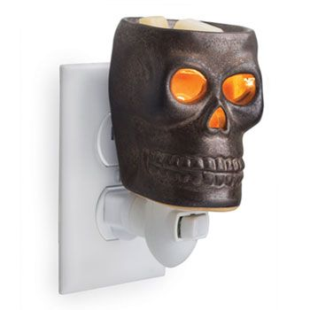 Skull Plug-In Wax Warmer This dark metallic spooky skull with glowing eyes and nose will be the highlight of the Halloween season. $15.95  #halloween #skull #decor #waxwarmer #plugin #scents #holiday #fun #fall #love