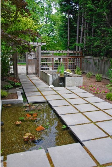 Modern koi pond with pavers backyard inspiration for Modern garden pond designs