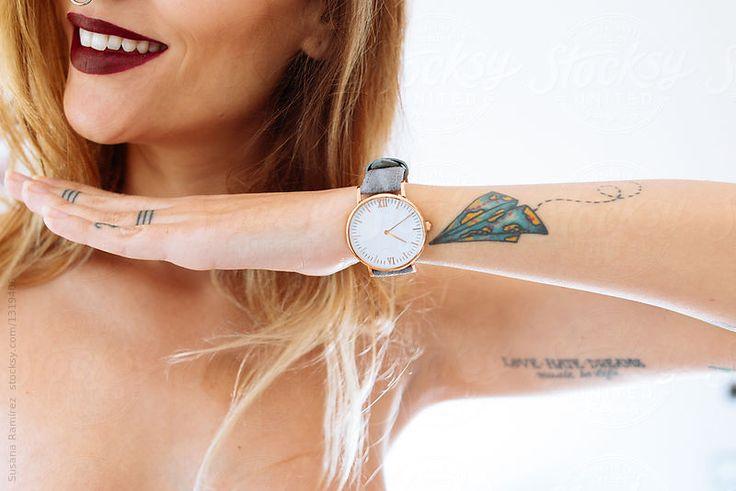 Detail of a woman's arm with wrist watch by Susana Ramírez for Stocksy United