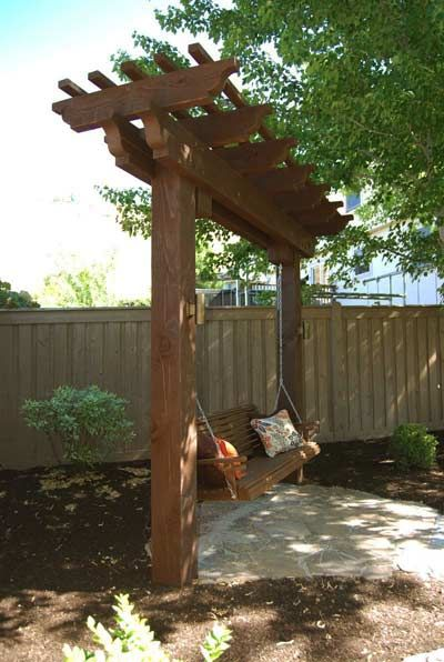 A timber frame garden arbor swing can help facilitate beautiful and inviting backyard living throughout the year.
