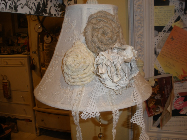 Vintage lace, vintage Bible page and burlap turned flowers I added on a free lamp given to me - in my craft studio.: Turning Flowers