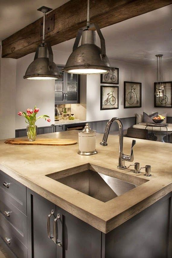 Industrial farmhouse kitchen with beamed ceilings, grey cabinets and concrete countertops