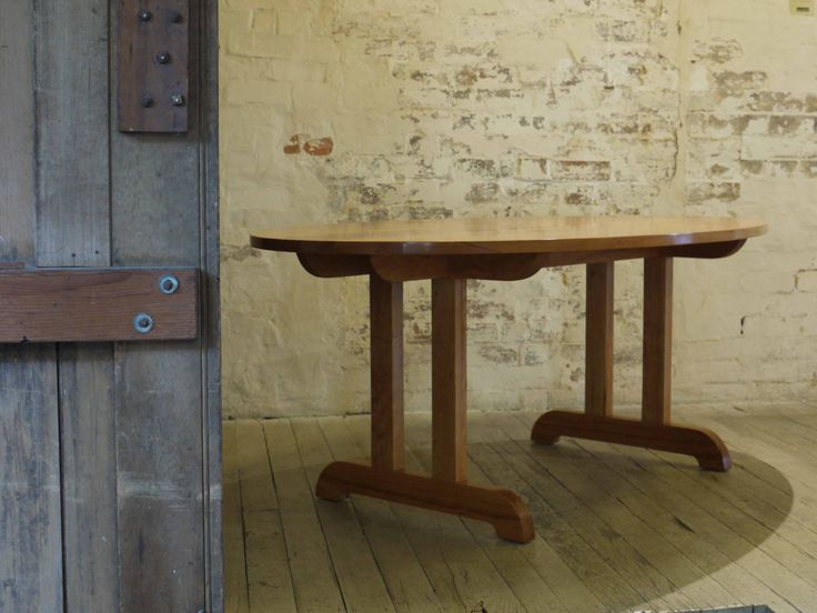 Made to Order Oval Dining Table in Cherrywood with an oil finish.