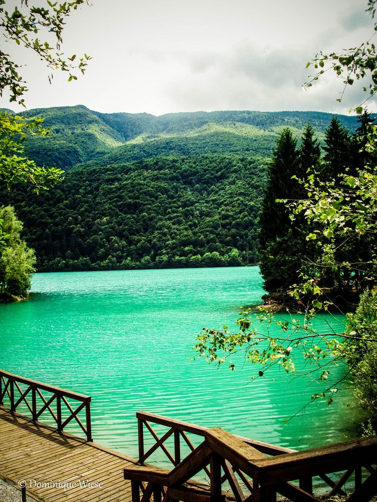artificial Lago di Barcis in the Friulian Dolomite region get's its turquoise hue from the rocks & minerals & Mt. fed spring.