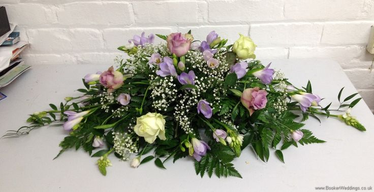 Lilac and Ivory Roses, Lilac Freesia, Gypsy Grass, Lilac Lissianthus with diamantes in roses Top Table Arrangement for The Racquet Club | Wedding Flowers Liverpool, Merseyside, Bridal Florist, Booker Flowers and Gifts, Booker Weddings