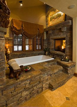 [Who needs a cabin when you have this bathroom oasis as for a retreat. Love this fireplace and soaker tub surrounded by stone.]
