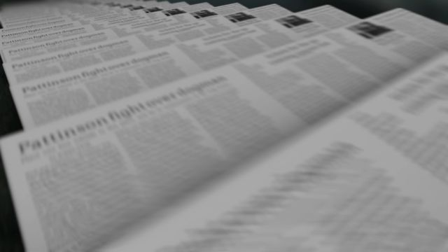 Downloadable motion graphic video of a newspapers that have been folded and fresh off the printing press ready to be delivered.