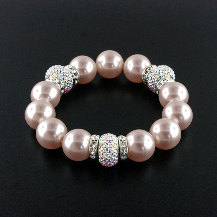 Luxurious Swarovski® charms and pearl make a fun, fabulous stretch bracelet.  Choose from 5 different pearl colors. Made in USA.