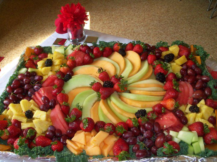 Decorative foiled, cookie sheet/fruit platter! All to BLESS, not impress! Cut fruits and arrange as pictured. Creative team player used her design gift to bless others at FCCC!