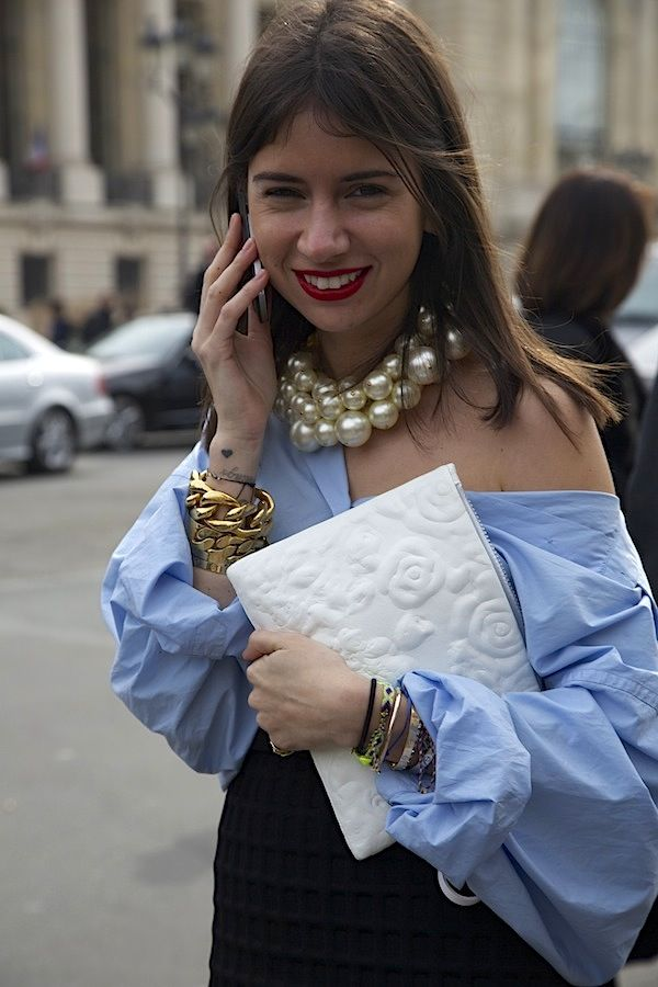 Love how easy she makes this look.  Messy oversized men's shirt, chunky pearls.  Love it!