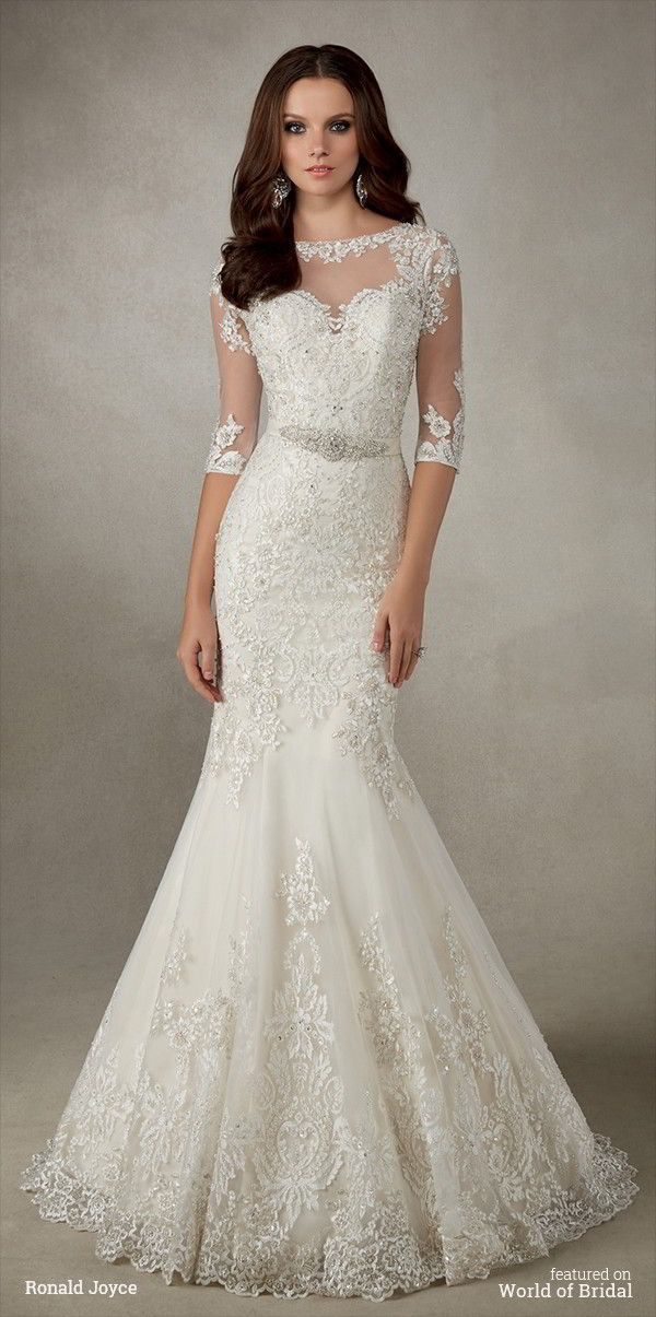 A classic lace fit and flare silhouette with ¾ length sleeves, illusion back and satin belt