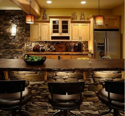 Kitchen - downstairs eventually - convert to a bar space. Just the design of rock and lighting