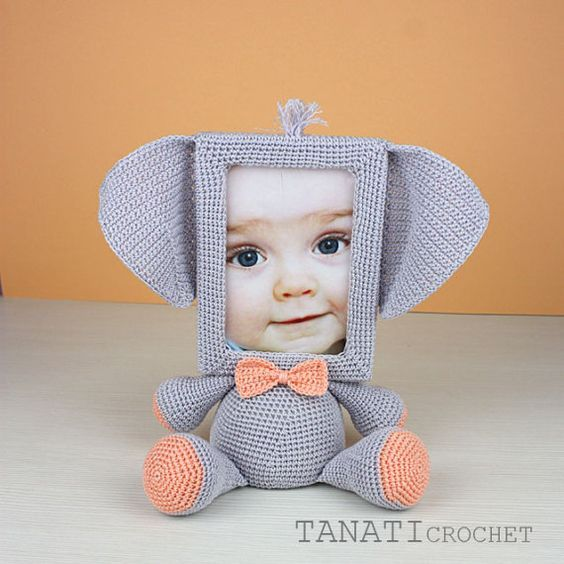 This is a crochet pattern (PDF file) NOT a finished doll you see on the photos! If you would like to purchase the finished toy, please dont hesitate to contact me. I can crochet it especially for you for $38 (shipping not included).  This pattern is available in English. SKILL LEVEL: INTERMEDIATE  Photo Frame ELEPHANT – size 25 cm (10 in), created from 100% cotton yarn.  Material: • yarn • hook 2.5 mm • glue gun • soft stuffing • scissors • Photo Frame 10x15 (frame width of 1.5 cm, thickness…