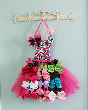 Trying to find a cute storage solution for that growing collection of hair bows and hair clips? These tutu bow holders are the answer! Each bow holder looks like a little dress. The bodice is crossed