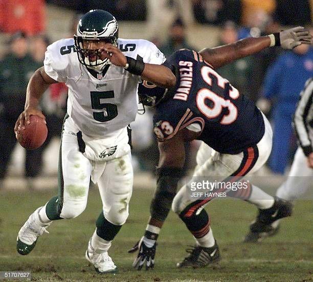 9978e77b Philadelphia Eagles quarterback Donovan McNabb scrambles away from ...
