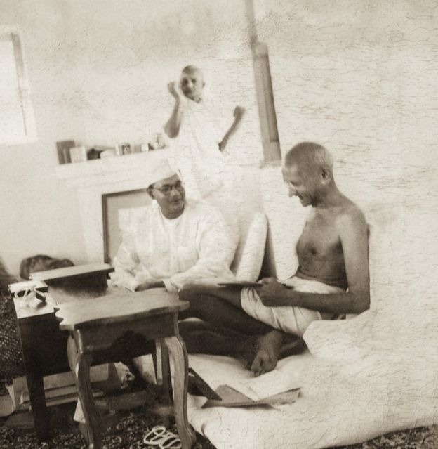 historic 1938 picture of Gandhi in a convivial mood with freedom hero and radical nationalist Subhas Chandra Bose. In the background, Kasturba Gandhi is drawing her sari, and looking into the distance. This was the high noon of Bose's political life: he had been elected as president of the Congress party. Gandhi had overruled objections from independence hero Sardar Vallabhbhai Patel, who had objected to Bose's appointment.
