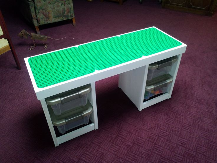 duplo lego table the top flips over and has lego boards attached to it