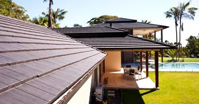 Boral Linea Concrete Roof Tile - Linea roof tiles are a cost effective alternative to the traditional slate shingle which gives a distinct, clean sweeping look to any house design.  Made of durable concrete, each tile is a rugged performer against heat, wind and rain. All Boral roof tiles come with a 20-year product guarantee.