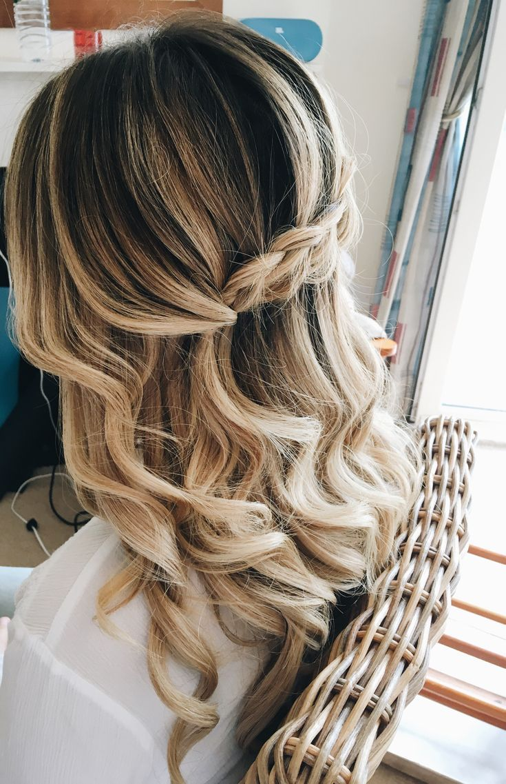loose braided hairstyle with waves for the boho bride