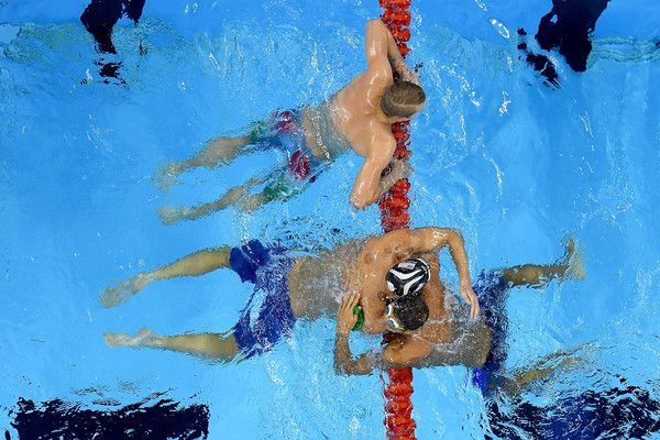 Michael Phelps (C) of the United States is congratulated by Chad le Clos of South Africa (R) in the Men's 200m Butterfly Final on Day 4 of the Rio 2016 Olympic Games at the Olympic Aquatics Stadium on August 9, 2016 in Rio de Janeiro, Brazil.