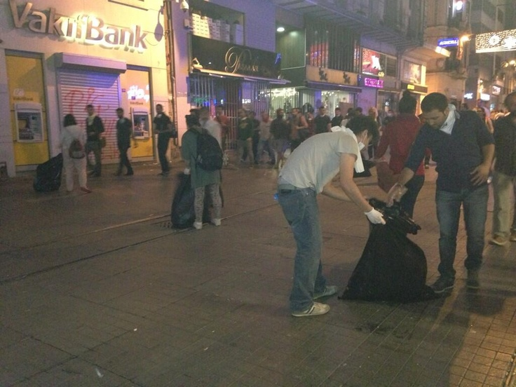 after clashes- protestors cleaning streets