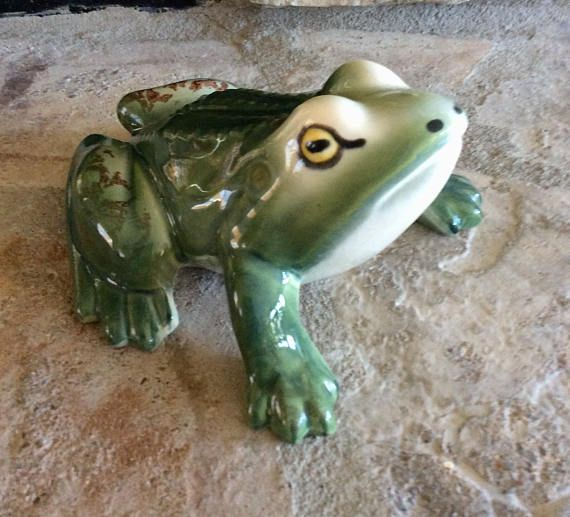 Sweet large ceramic frog figurine in realistic handpainted colors of green , with brown spots on legs & eyes of yellow & black. In very good vintage condition, no chips or cracks! Ready to display in window box, kitchen, by plants or bookshelf. Shipped insured! Measures 6 long x 5.25 wide x 3.5 height Thanks for shopping YellowHouseDecor! Check out my sisters shop for more vintage items ellansrelics02.