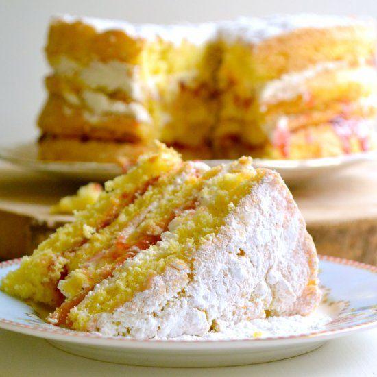 An indulgent, fatless, sponge cake, layered with whipped cream and plum jam.