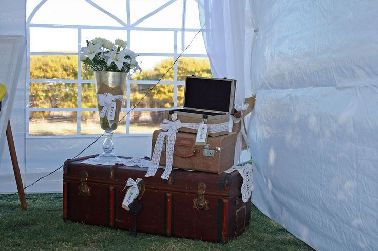 Rustic/ vintage suitcases used for wishing well & gifts table. Dressed with hessian & lace to tie in with theme.