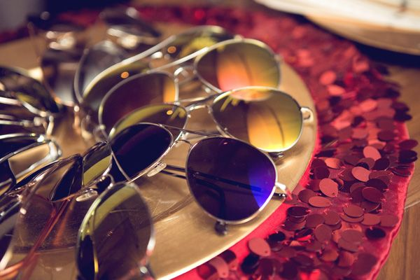 Provide your guests with sunglasses for a movie night featuring The Hangover on an inflatable movie screen - Southern Outdoor Cinema expert tip for theming and enhancing an outdoor movie event.