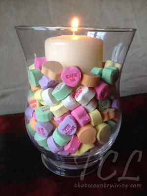 Quick and Easy Valentine's Day Candle Centerpiece — frugal Valentine candle centerpiece featuring the quintessential Valentine's Day candy – Conversation Hearts! Devon from That's Country Living shows you how.