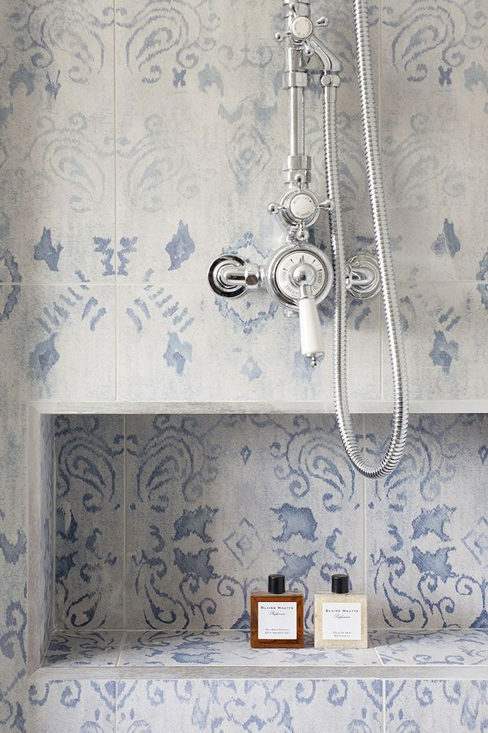 Parisian apartment style. Beautiful tiles with faint, dusty blues threaded through.                                                                                                                                                                                 More